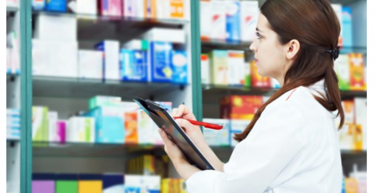pharmacist_standing_in_front_of_medication