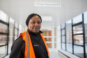 Lady standing in a hospital
