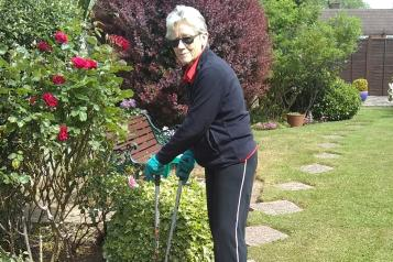 Lady outside gardening