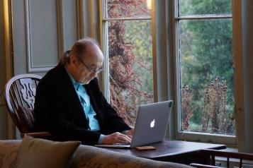 Picture of man using laptop in his home