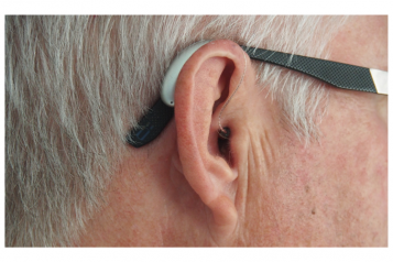 Side profile of a man wearing a hearing aid