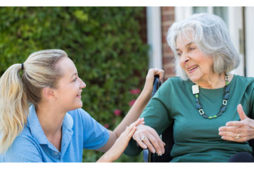 elderly_lady_and_carer_outside