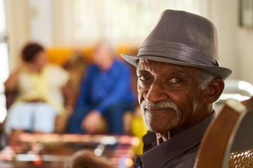 Picture of Older black man seated and smiling