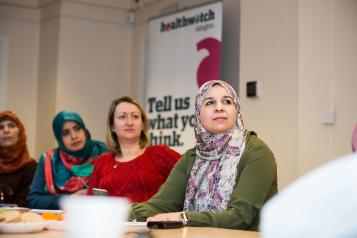 Three ladies at a Healthwatch meeting