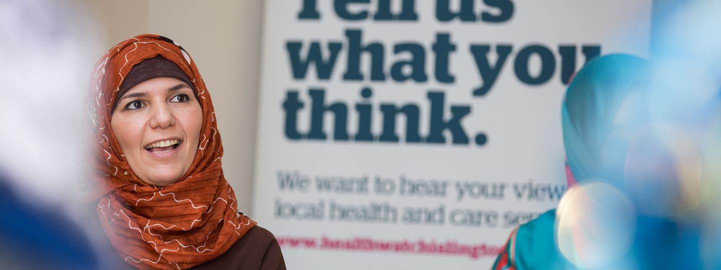 Lady at a Healthwatch meeting gathering information