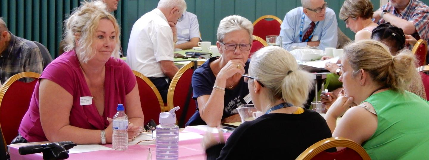 Table discussion at Healthwatch event